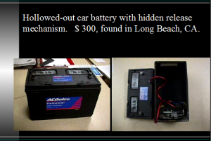 Image of Hollowed out car battery with hidden release mechanism.
